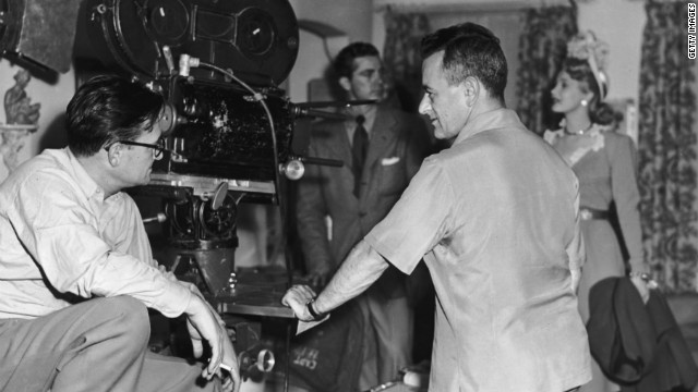 Cinematographer Gregg Toland, left, William Wyler, Dana Andrews and Virginia Mayo on