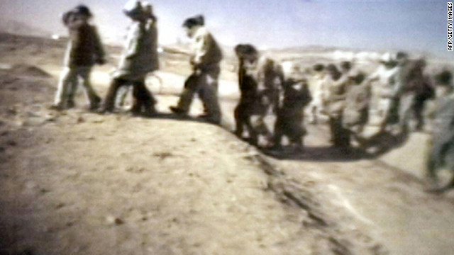 A 2005 video grab from Japanese TV apparently shows North Korean prisoners heading to a public trial.