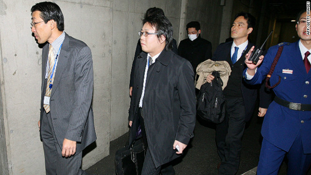 Investigators enter the headquarter of Olympus in Tokyo on December 21, 2011.