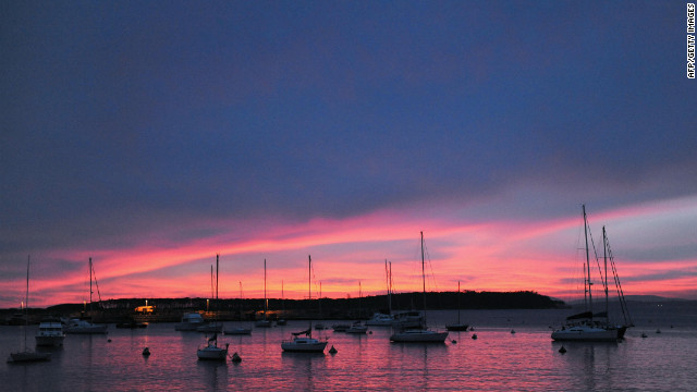 A view of a sunset over the harbor of seaside resort Punta del Este.
