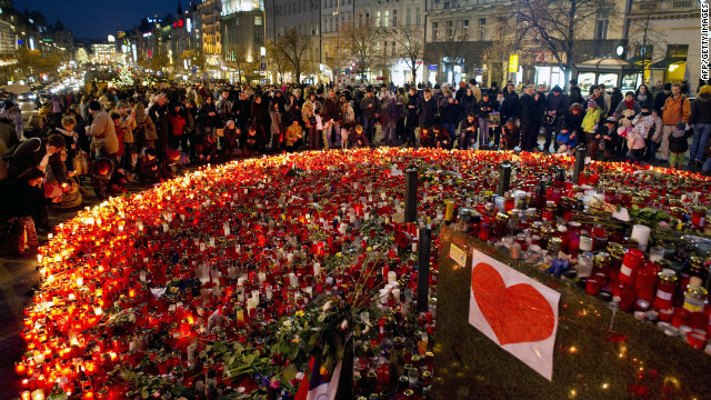 Candles and flowers fill the ground at Vaclavske Square as citizens pay their respects. Havel was 75.