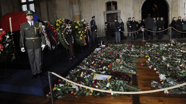 Soldiers stand next to Havel's flag-draped coffin, ahead of his funeral
