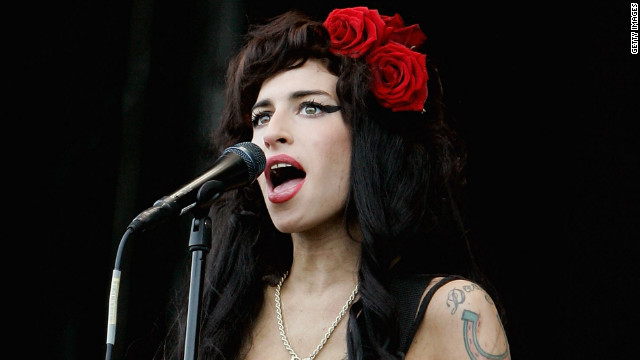 A wedding dress Amy Winehouse wore at her 2007 nuptials has been taken from her former home. 
