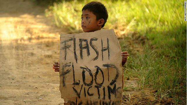 A boy holds a placard on a street in Cagayan de Oro on December 24, 2011.