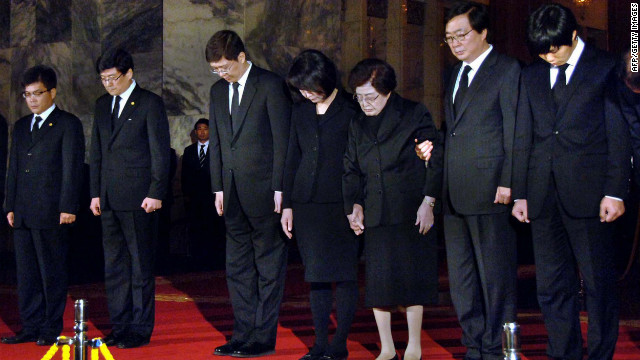 South Korea's former first lady and her delegates offer condolences to late North Korean leader Kim Jong Il.