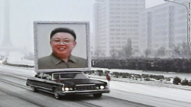 This TV grab taken from North Korean TV December 28 shows a car in Pyongyang with a portrait of the late leader Kim Jong Il.