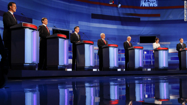 Republican presidential candidates debate in Sioux City, Iowa, on December 15. With the Iowa caucuses beginning in days, the candidates have begun touring the state to gain support.