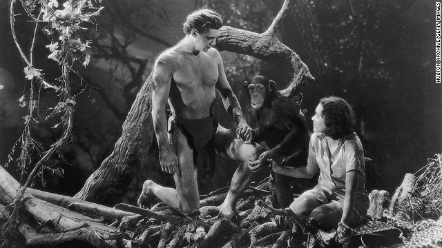 Johnny Weissmuller and Maureen O'Sullivan hold hands with Cheetah the chimpanzee in