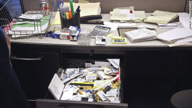 Her desk drawers are filled with unknown amounts of work and personal supplies.