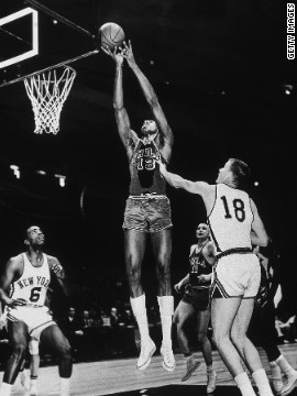 Two days after scoring 100 points during a game against the New York Knicks, Philadelphia Warriors Wilt Chamberlain scores again against the Knicks. Unfortunately, the great record-grabbing moment was not captured on camera.