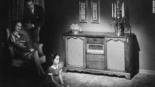 A family listens to a Magnavox Concert Grand radio in their home. Hit radio programs &quot;Suspense&quot; and &quot;Yours Truly, Johnny Dollar&quot; aired the last broadcasts in 1962. Many would say this ended the &quot;Golden Age of Radio.&quot;