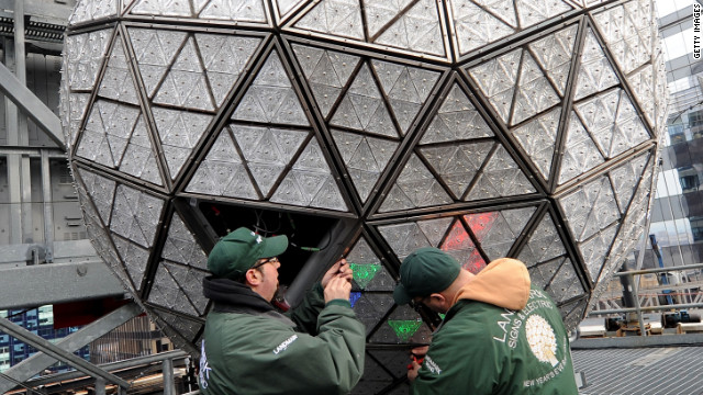 Workers attach 288 new Waterford Crystal triangles on the 2012 Times Square New Year's Eve Ball.