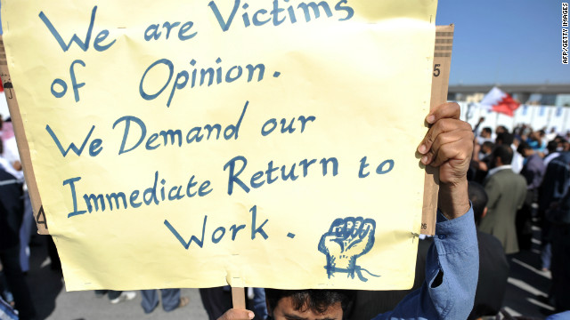 A Bahraini man protests Tuesday at a rally of employees who lost their jobs for
