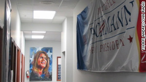 An impressionist painting of Michele Bachmann hangs in her campaign office, the same one John McCain used in 2008.