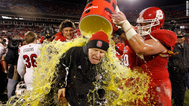 Coach Tom O'Brien of the North Carolina State Wolfpack gets doused after the Belk Bowl in Charlotte, N.C., on Tuesday.