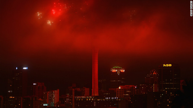 New Zealand was among the first countries to ring in the new year, but the fireworks display at the top of Auckland's Sky Tower was obscured by low clouds.