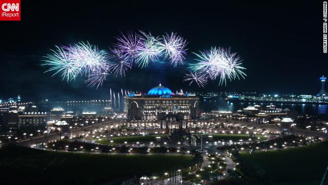 Fireworks illuminate the Emirates Palace and Marina mall as 2012 arrives in Abu Dhabi.
