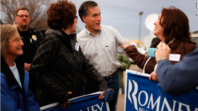 Mitt Romney does some last-minute campaigning in Le Mars, Iowa, just days before the Iowa caucuses.
