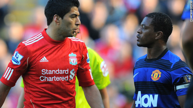 Luis Suarez and Patrice Evra are involved in a heated exchange during the October 15 match at Anfield.