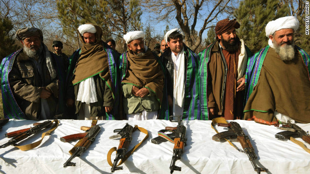 Taliban fighters join Afghanistan government forces at a ceremony in December, 2011.