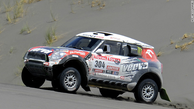 Krzysztof Holowczyc of Poland takes his Mini to second place on stage three of the Dakar Rally to take the overall lead.