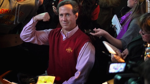 We'll say this for the sweater vest -- it sure shows off Santorum's guns. And solid red is a always an appropriate choice for a GOP candidate. Here Santorum poses for a picture while hosting a Pinstripe Bowl- watching party at a restaurant in Ames, Iowa. Go Cyclones!
