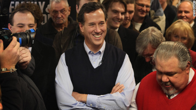 Santorum looks relaxed here in a navy blue sweater vest, layered nicely over a light-blue dress shirt. We're sure supporters at the Daily Grind coffee shop in Sioux City, Iowa, picked up on the subtle presidental tones. 