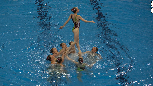 A synchronized swimming team performs during a ceremony in July at the newly-built Aquatic Center in London's Olympic Park.