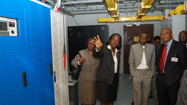 The governor of Central Bank of Nigeria, Lamido Sanusi (middle), tours the Lagos landing station.