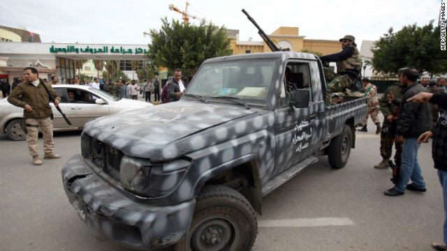 Libyan gunmen gather along in the Libyan capital Tuesday after clashes erupted between militias from Tripoli and Misrata.