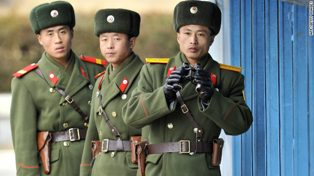 North Korean soldiers look at South Korea across the Korean Demilitarized Zone (DMZ), on December 22, 2011.