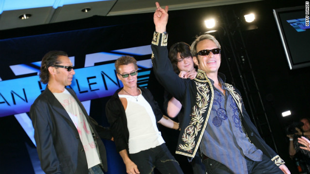 David Lee Roth walks offstage with the rest of the band (L-R) Alex Van Halen, Eddie Van Halen and Wolfgang Van Halen at the Van Halen press conference announcing their new tour at the Four Seasons Hotel on August 13, 2007 in Los Angeles, California