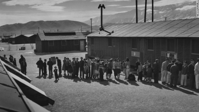 In this 1943 photo, people line up at the mess hall at the Manzanar Relocation Center, a Japanese internment camp in California.