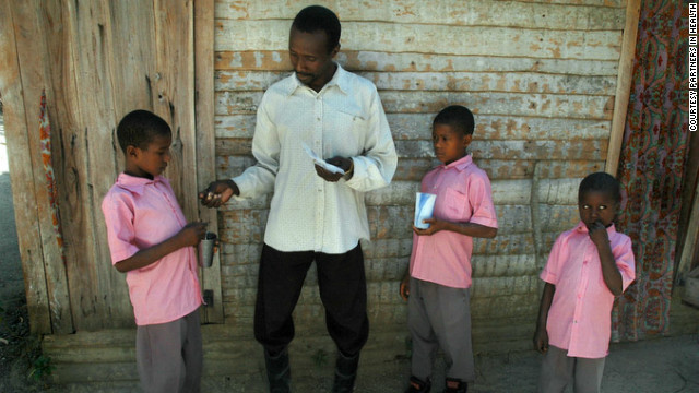 A community health worker makes a home visit in Haiti. After the initial emergency relief, Partners in Health is focusing on rebuilding Haiti's larger public health and medical education systems and on strengthening specialized medical services.