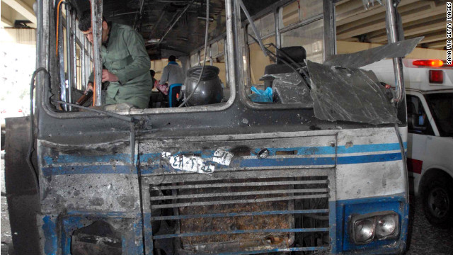 A photo released by the Syrian News Agency shows a damaged bus at the site of Friday's suicide bombing in Damascus.