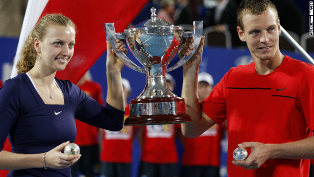 Czech tennis stars Petra Kvitova, left, and Tomas Berdych celebrate winning the Hopman Cup in Perth on Saturday.
