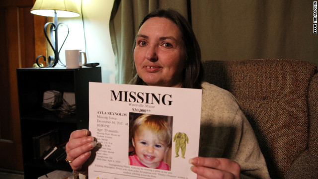 Phoebe DiPietro, the grandmother of missing Maine toddler Ayla Reynolds, holds a missing persons poster.