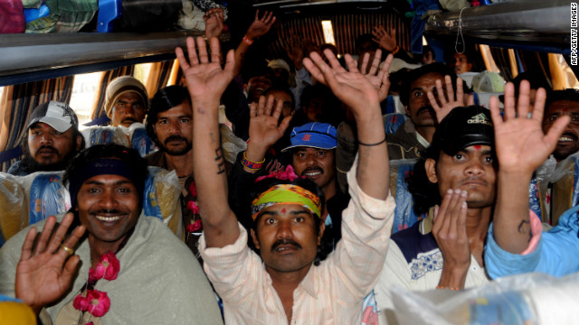 Indian fishermen wave after Pakistani authorities freed them from jail in Karachi on January 7, 2012.