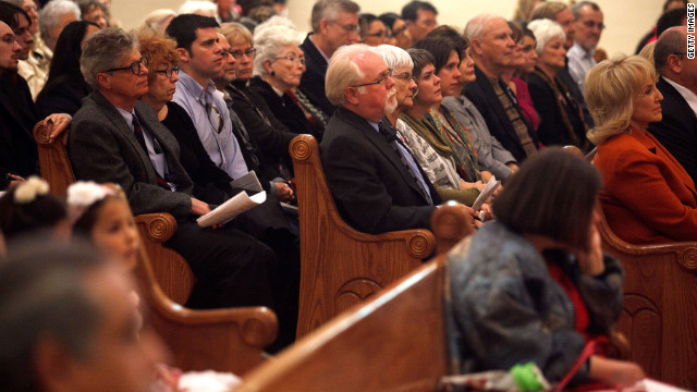 Arizona Gov. Jan Brewer, right, attends an interfaith memorial service at St. Augustine Cathedral in Tucson on Sunday. 