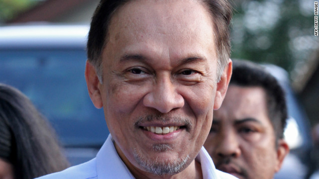 Malaysia opposition leader Anwar Ibrahim leaves his residence in Kuala Lumpur Monday on the day of the verdict.