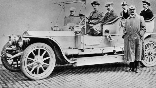 The Rolls-Royce Silver Ghost achieved a world record in 1907 by driving 14,371 miles without an involuntary stop, establishing the car's reputation for reliability.