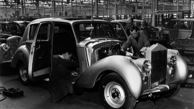 Rolls-Royce craftsmen show their attention to detail as a Silver Dawn rolls down the assembly line at Crewe in 1950.