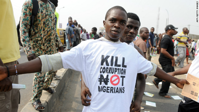 A protester sports a an anti-corruption T-shirt in 2012 in Lagos. Femi Kuti says it's time for world leaders to join the fight.