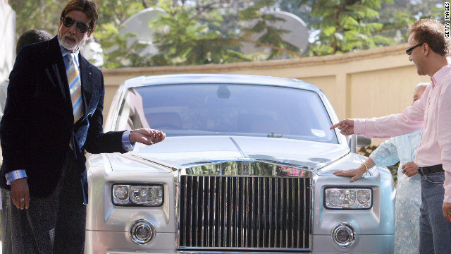 Bollywood actor Amitabh Bachchan, left, and director Vidhu Vinod Chopra pose with a Rolls-Royce Phantom in Mumbai in February 2007.