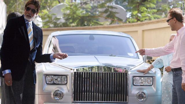 Bollywood actor Amitabh Bachchan, left, and director Vidhu Vinod Chopra pose with a Rolls-Royce Phantom in Mumbai in February 2007.