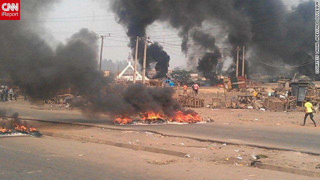 "Bonfires were set ablaze by protesters outside Lagos State University. iReporter Lawal Adekunle Olusegun said: ""I know a lot of people around are suffering and going through a hard time the fuel subsidy is only making things worse for a lot of people."""