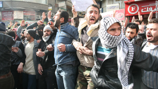 Men line up before the body of a man reportedly killed during a protest in the Damascus neighborhood of Koudsia in Syria. CNN captured images of both pro- and anti-government protesters as they took to the streets in Syria's capital on Monday.
