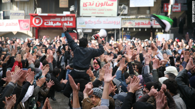 The crowd in Koudsia chants slogans against President Bashar al-Assad while waiting for the a funeral to begin.