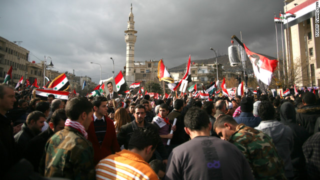 A rally in support of Syria security services takes place in Damascus' Sabaa Bahrat, or seven fountain square.