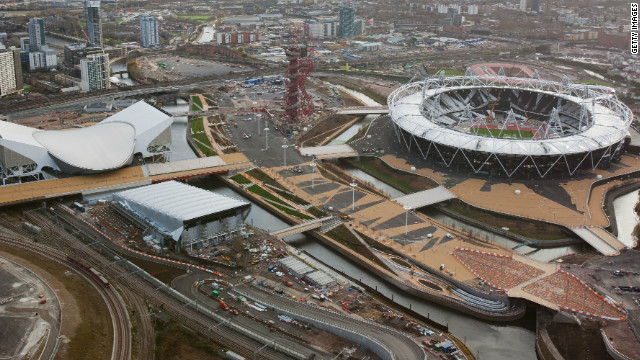The site had been completely transformed by December 2011, with the newly-constructed Olympic Stadium (right) the main attraction. This picture also shows the Aquatics Centre (far left), with the Water Polo Arena in the foreground. Also visible is the 115-meter high steel structure known as The Orbit.